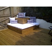 Slabs of white cushions were made out of white linens with coordinating cushions. Making a perfect sun lounge area